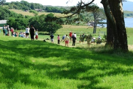 Clan members dueling it out at tug of war outside Raasay House